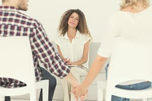 Couple holding hands in therapy session