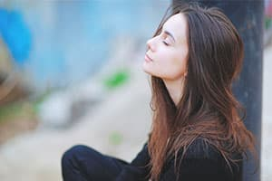 woman meditating finding peace of mind