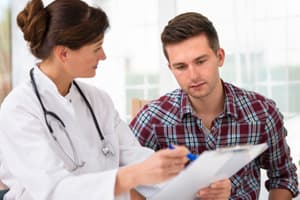Female portraying doctor speaking with male patient about treatment for xanax addiction