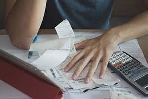 Man going through receipts concept of financial problems