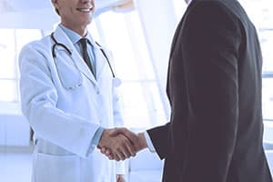 business man shaking hands with doctor