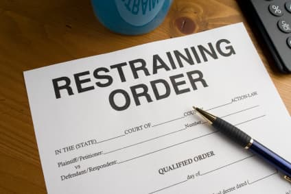 A restraining order  is a form of legal injunction that requires a party to do, or to refrain from doing. A party that refuses to comply with an order faces criminal or civil penalties and may have to pay damages or accept sanctions.